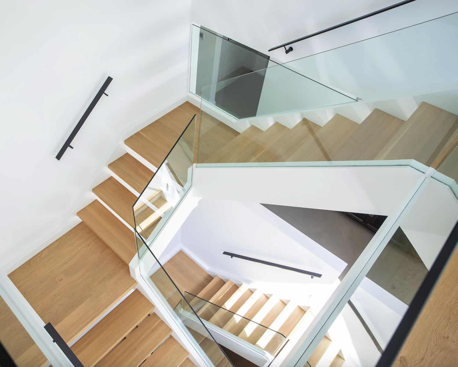 modern-staircase-with-wood-steps-and-glass-railings