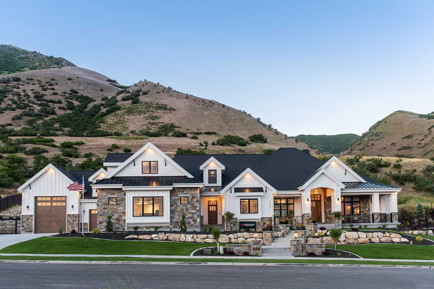 Farmhouse style dream house in Utah with a mountainous backdrop