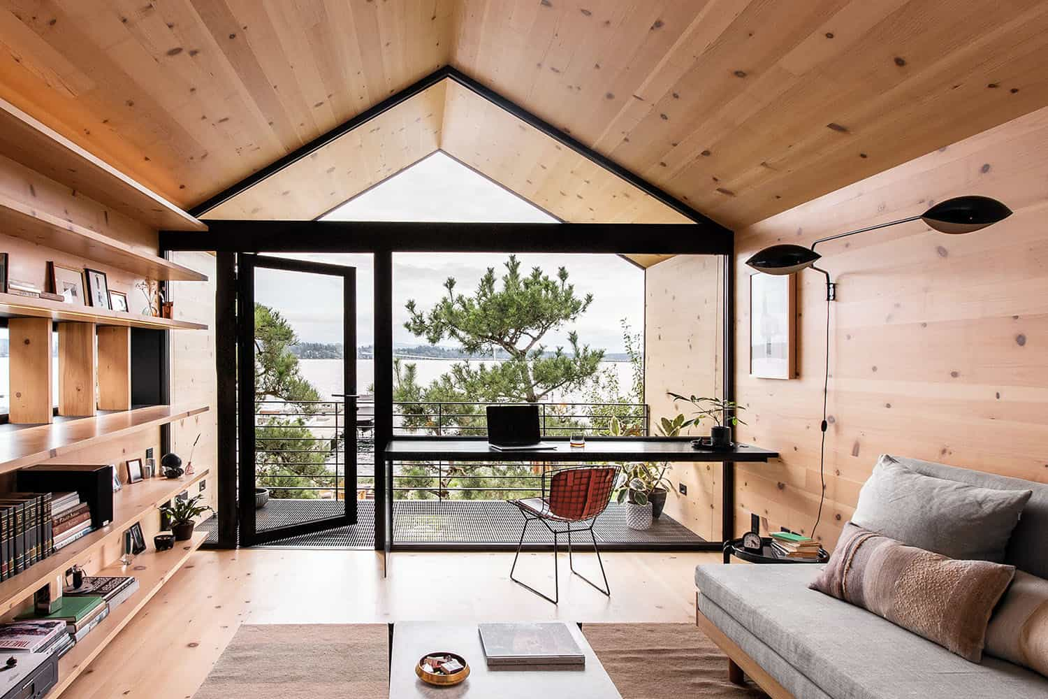 Compact wooden shelter captures views over Seattle shoreline