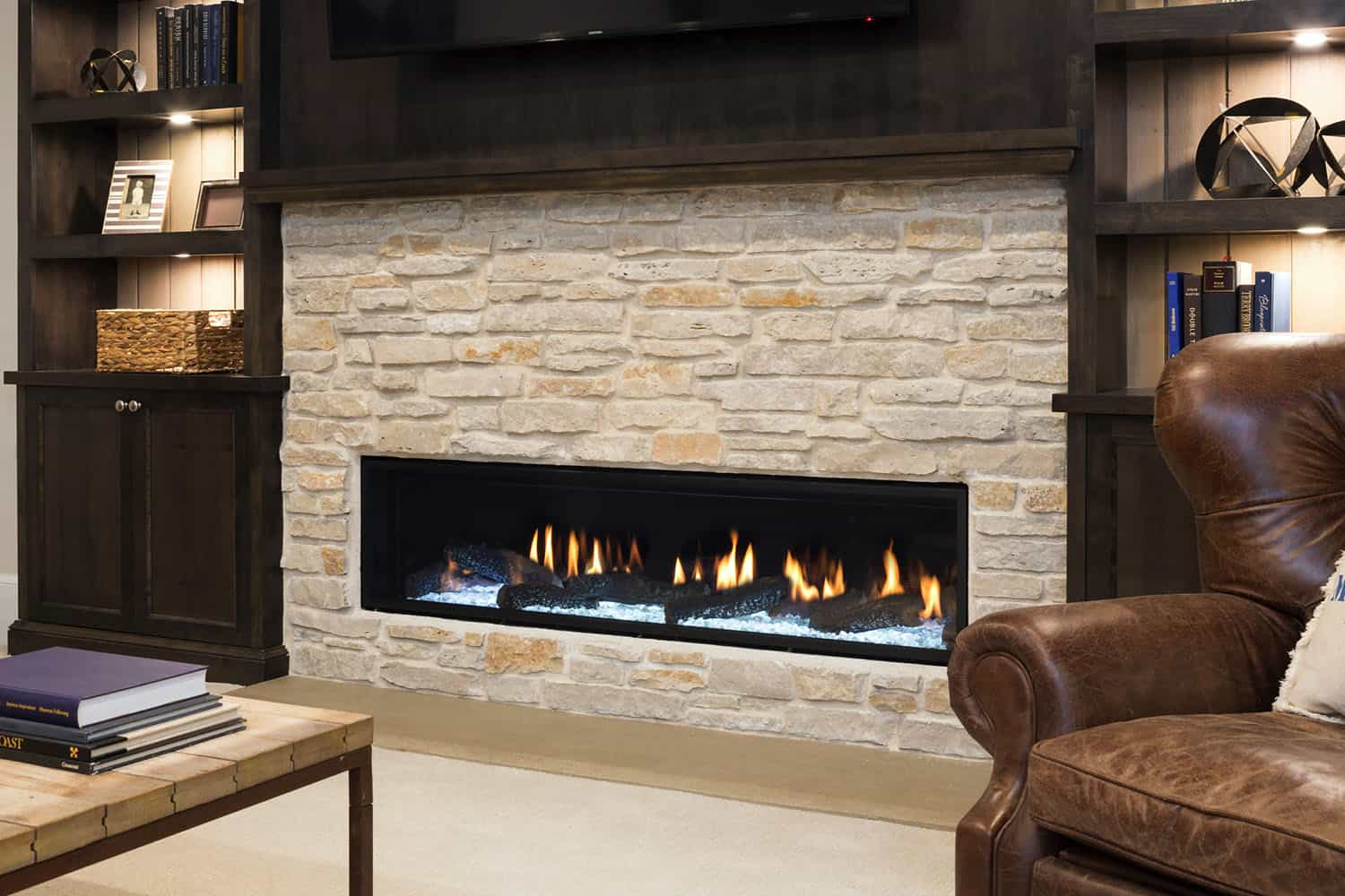 beach-style-basement-media-room-fireplace