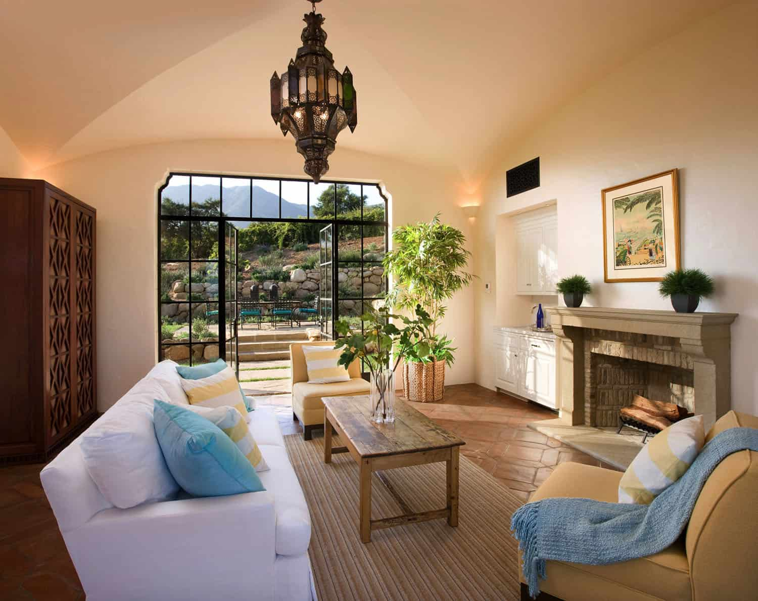 mediterranean-style-family-room-and-fireplace-and-patio