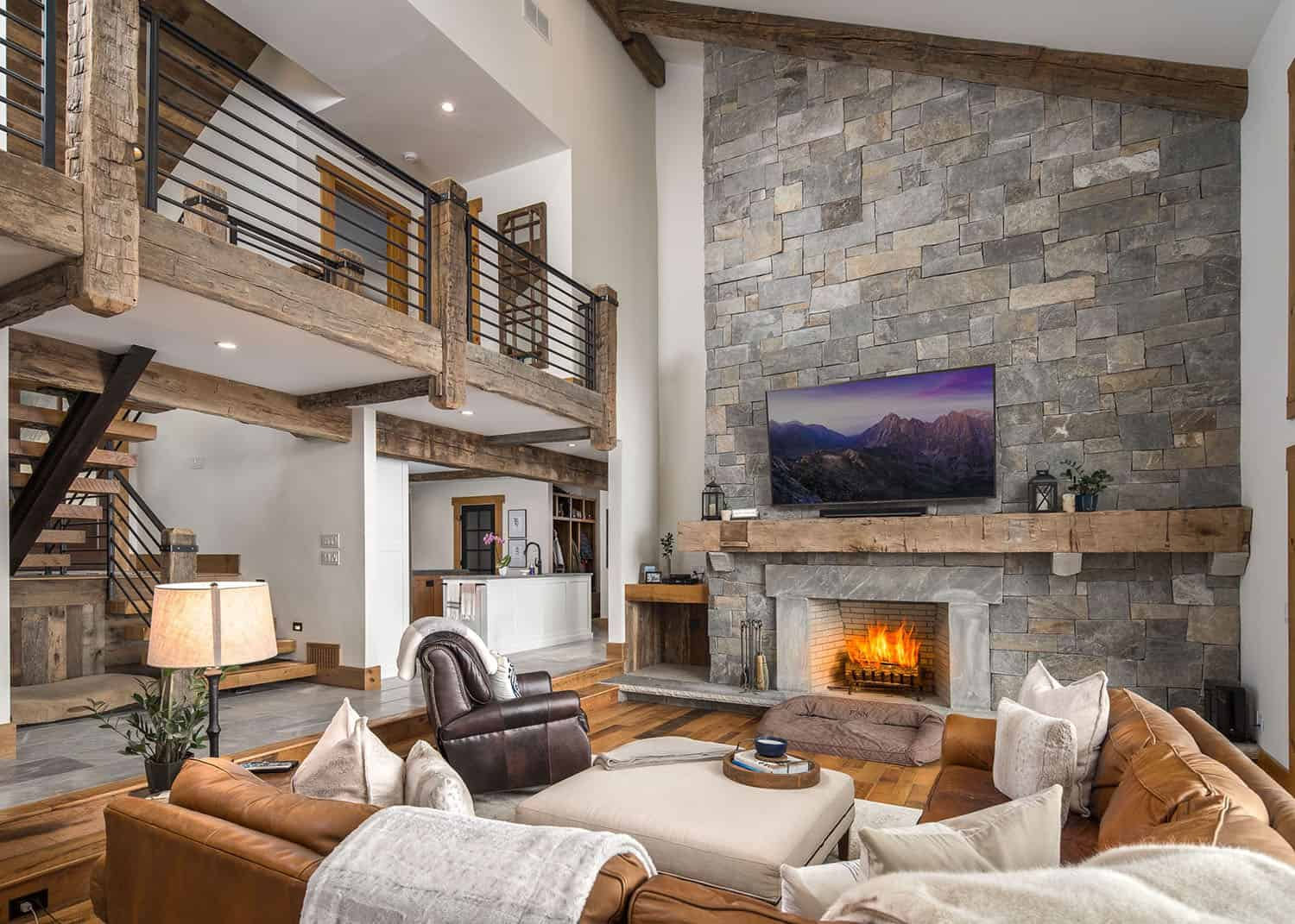 modern-mountain-home-great-room-stone-fireplace