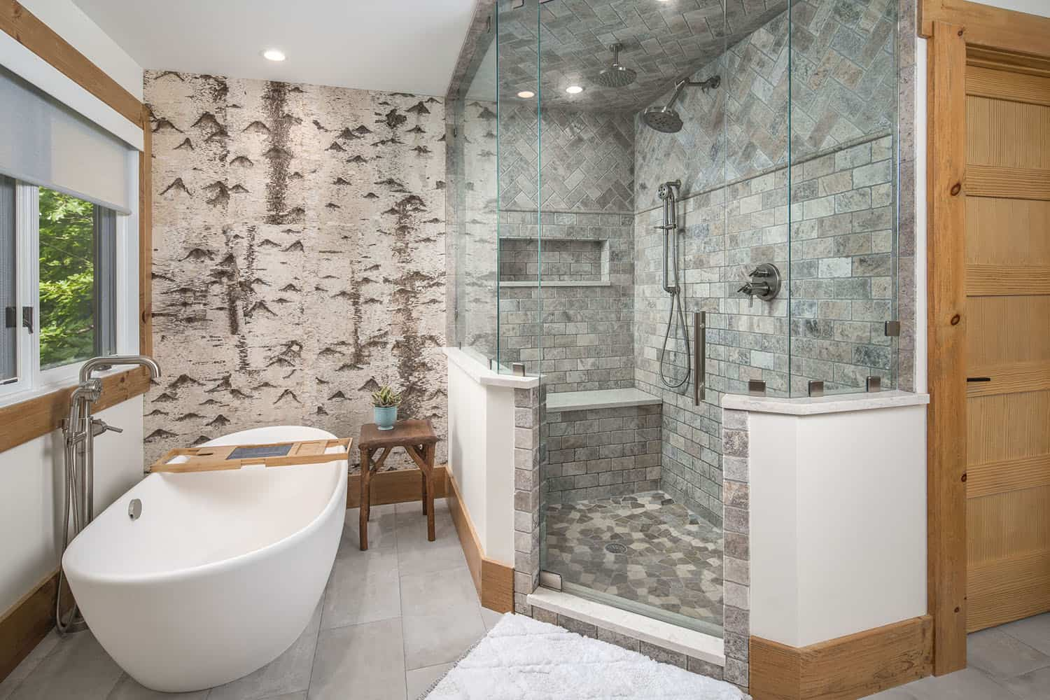 glass-shower-freestanding-tub-birch-accent-wall