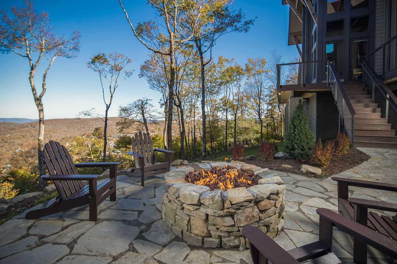 rustic-ski-retreat-patio-fireplace