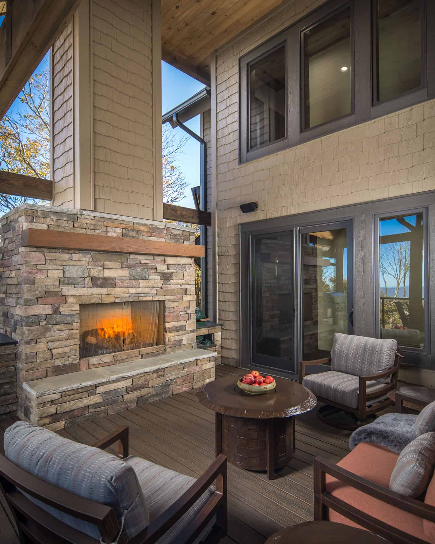 timber-frame-mountain-retreat-covered-patio-fireplace
