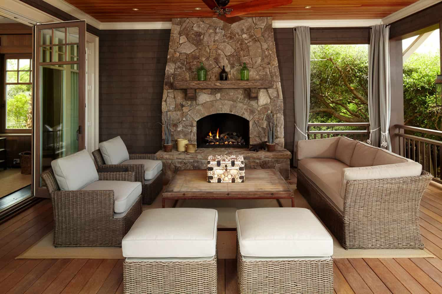 beach-style-screen-porch-design-with-fireplace