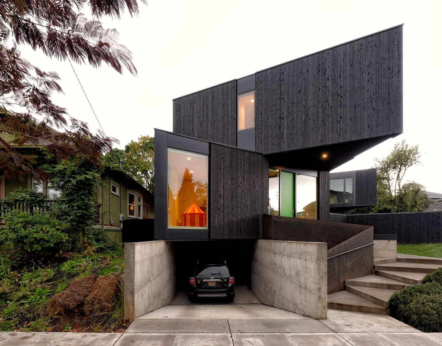 Modern prefabricated house with a blackened cedar facade in Oregon