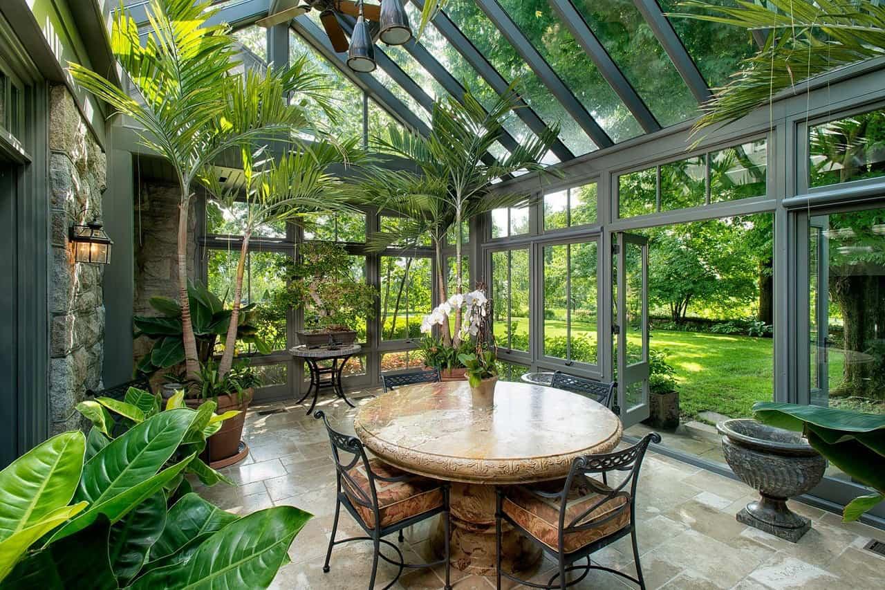 solarium-design-ideas-dining-room-with-greenery