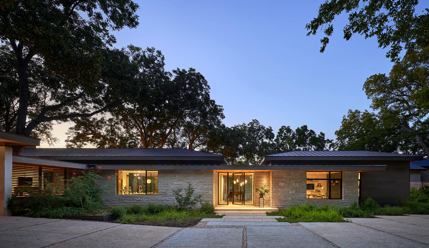 hill-country-contemporary-home-exterior-night