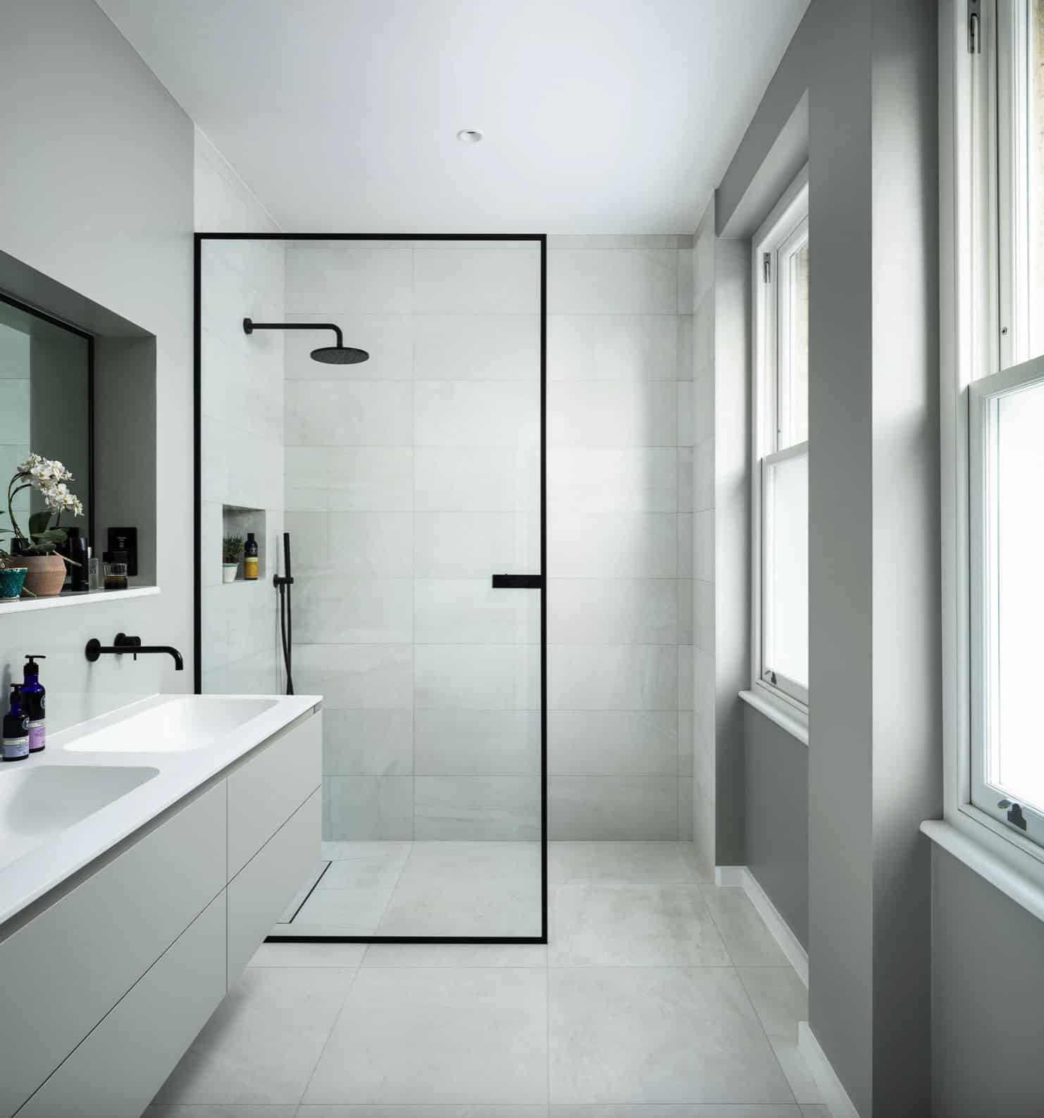 clean-white-minimal-shower-design-with-partial-glass-wall