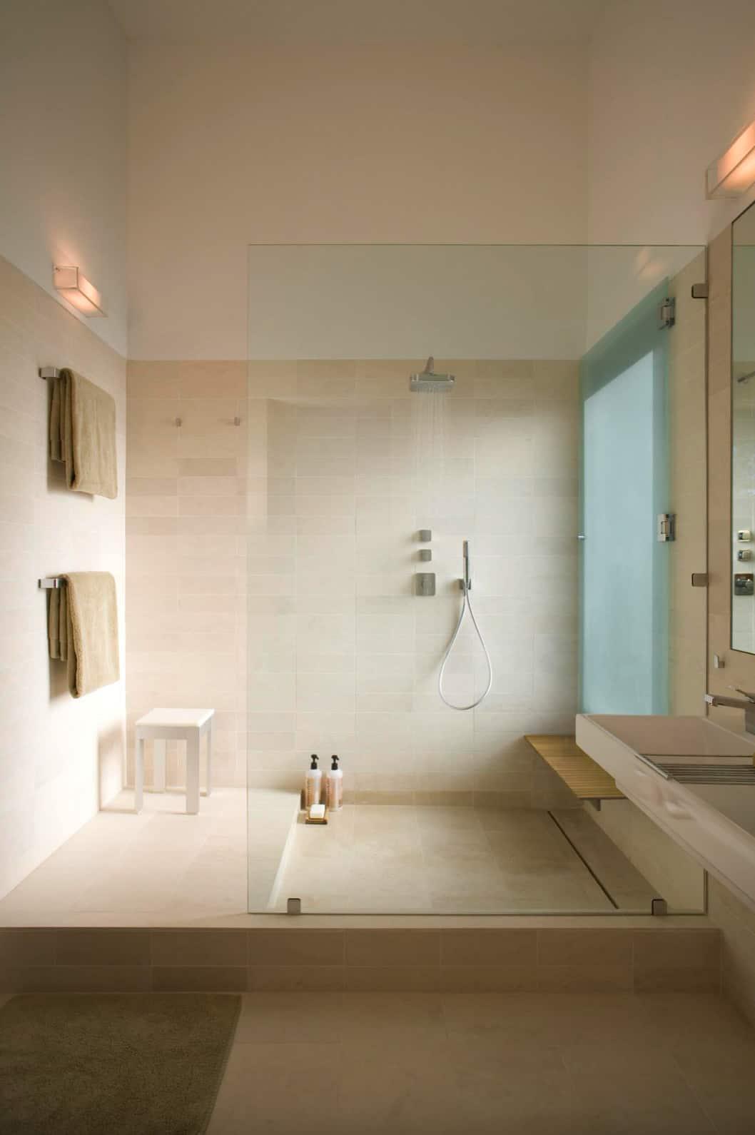 minimal-sleek-limestone-tile-walk-in-shower