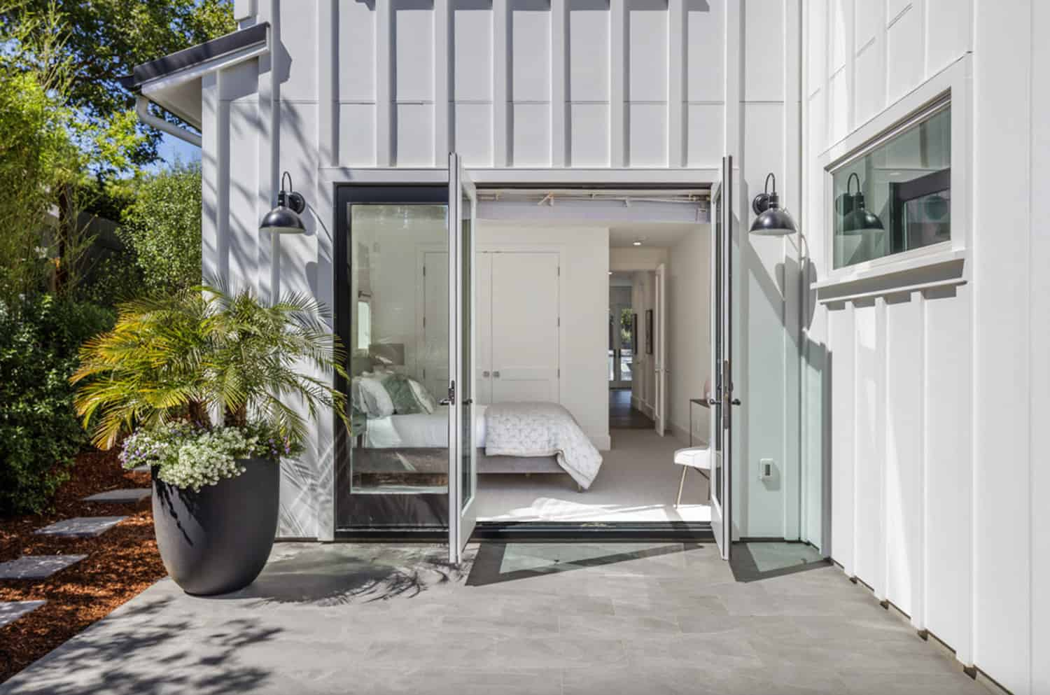 traditional-home-bedroom-viewed-from-exterior-through-glass-french-doors