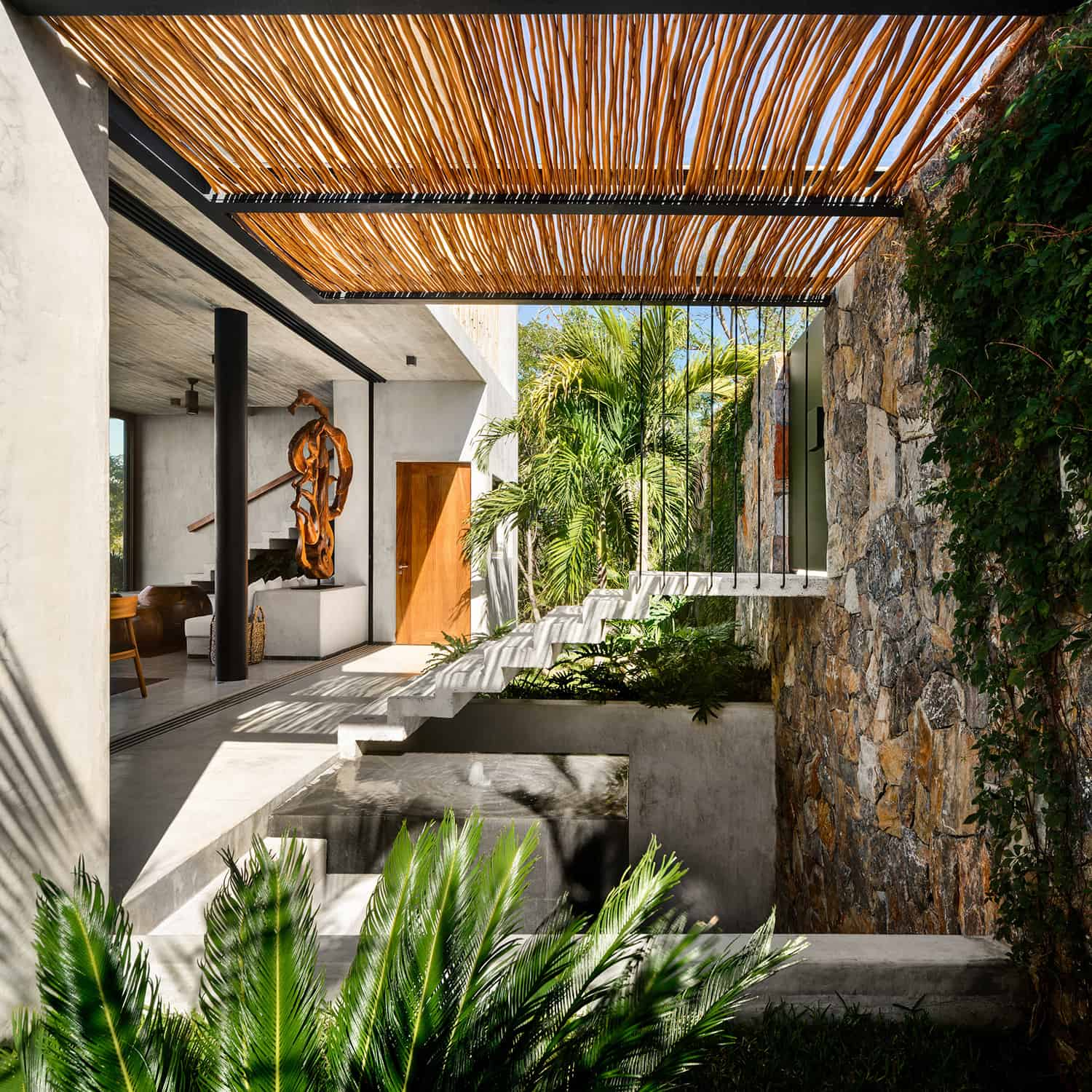 tropical-minimalist-holiday-home-entry-staircase