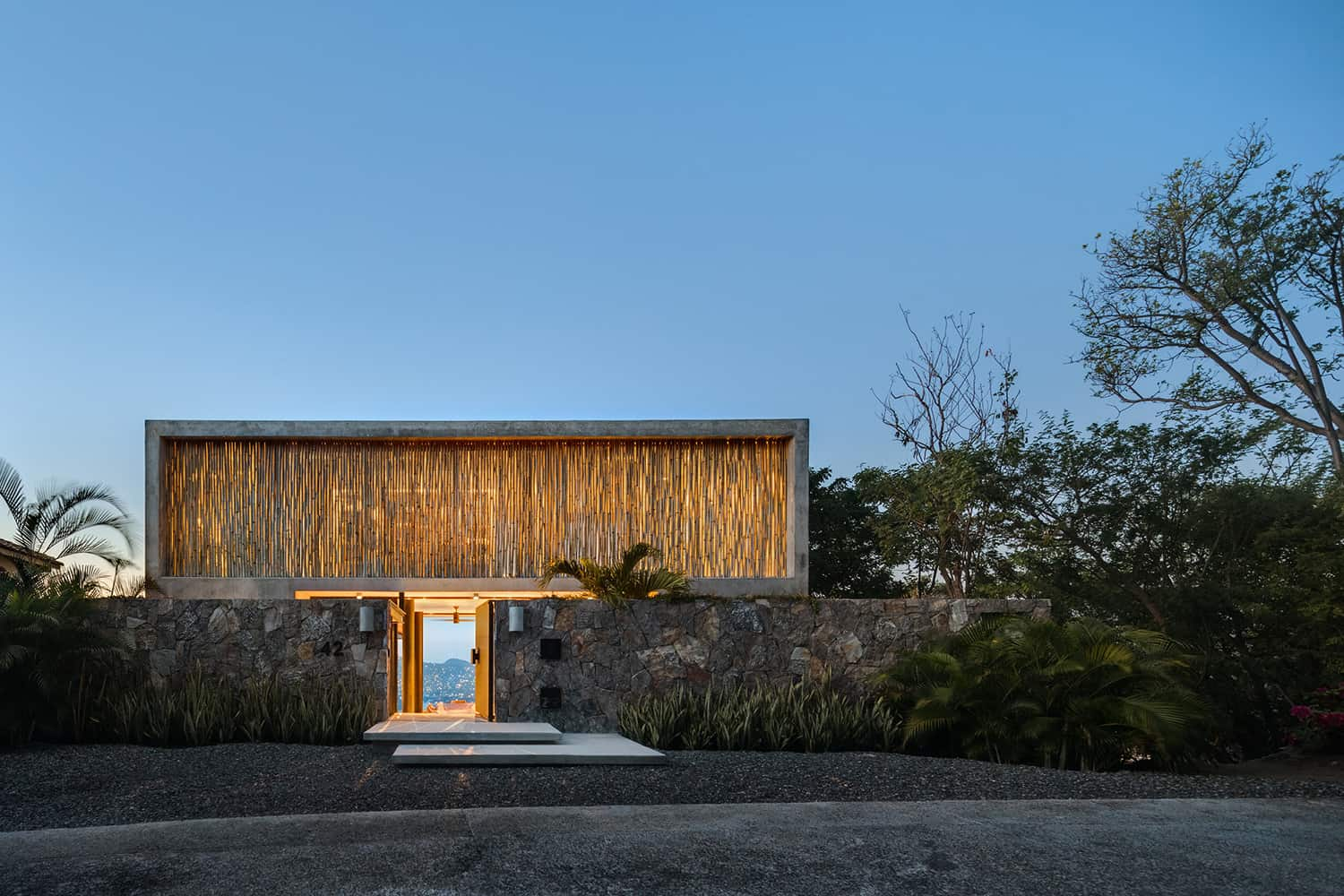 tropical-minimalist-holiday-home-exterior-night