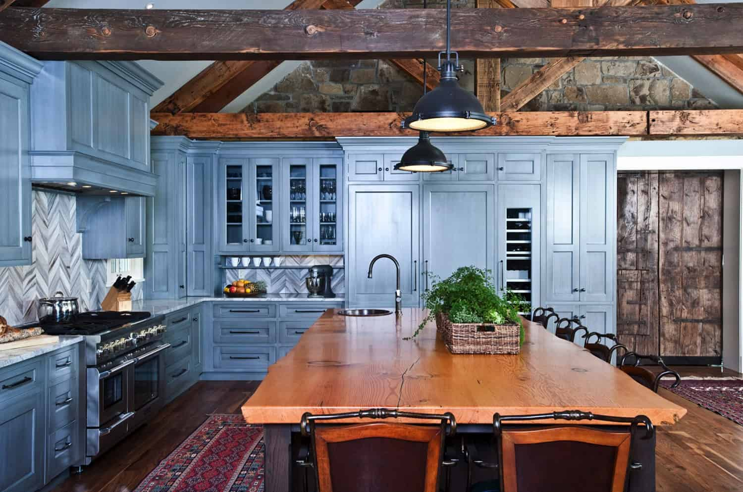 rustic-stone-wall-kitchen-with-blue-painted-cabinets