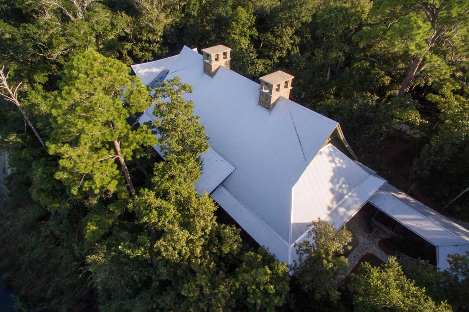 rustic-bayfront-home-exterior-aerial-view