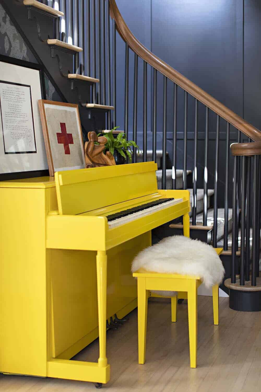 farmhouse-entry-with-camouflage-wallpaper-and-yellow-vintage-piano