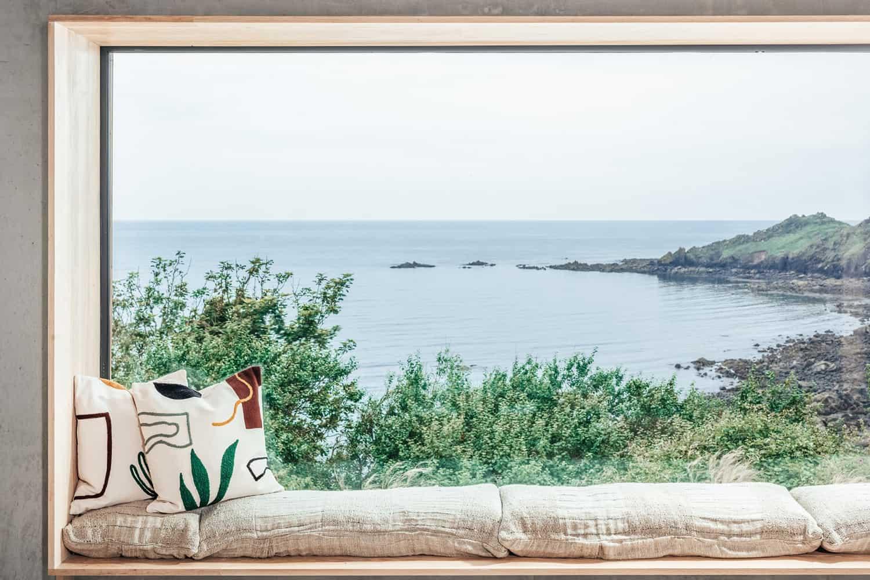 modern-Scandinavian-living-room-window-seat-with-coastal-view