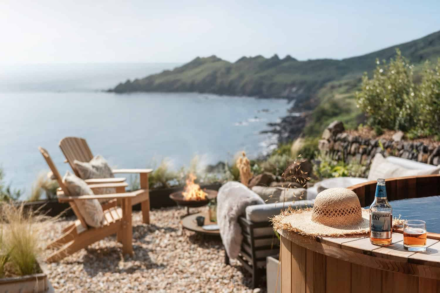 modern-Scandinavian-patio-with-a-hot-tub-and-firepit