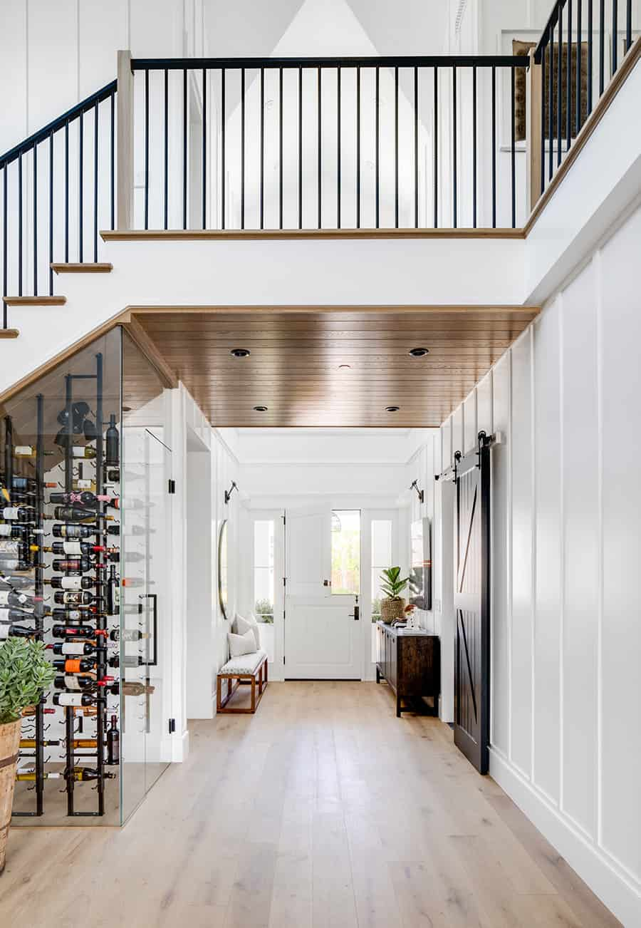modern-entry-with-wine-cellar-under-stairs