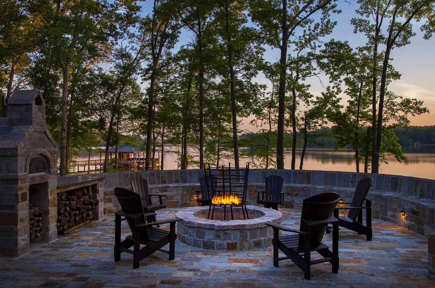 rustic-outdoor-patio-with-a-fire-pit-overlooking-the-lake