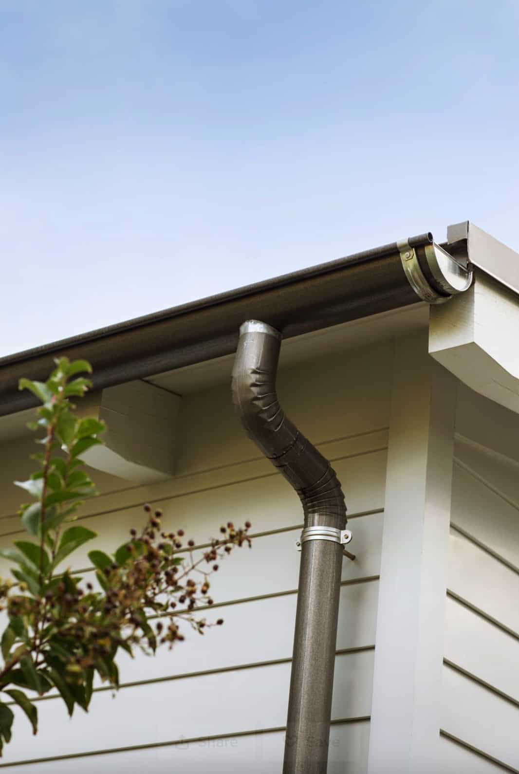 gutter-and-downspout-detail-on-traditional-house-exterior