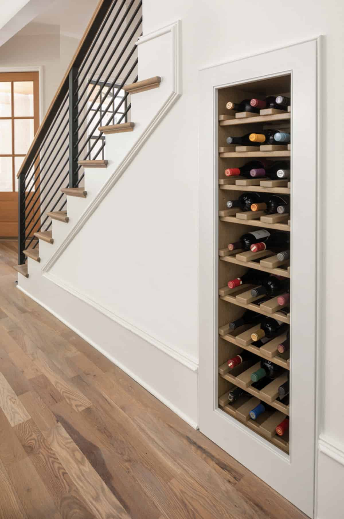 transitional-staircase-built-in-wine-wall