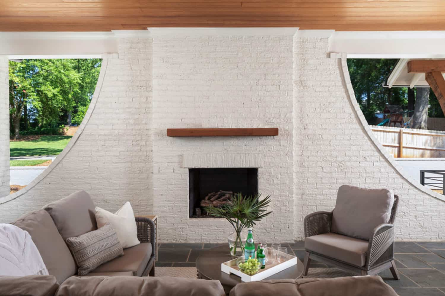 transitional-covered-porch-fireplace
