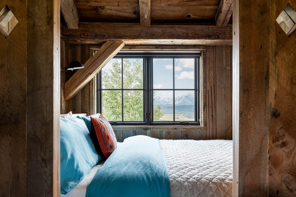 dutch-barn-built-in-window-seat-bed-with-sliding-barn-doors