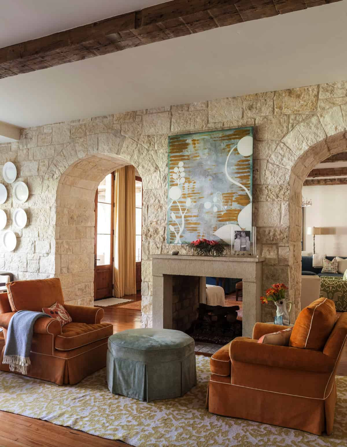 traditional-living-room-with-dual-sided-fireplace
