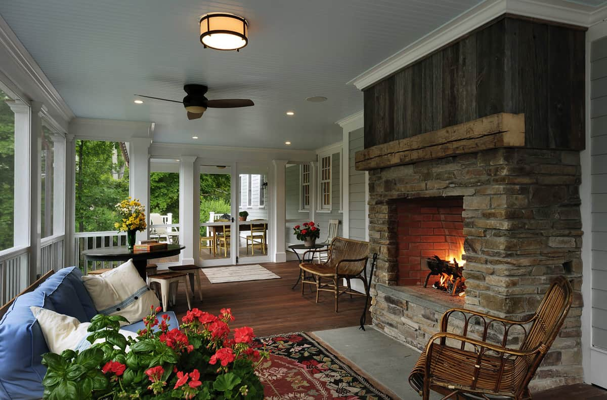 traditional-country-style-screened-porch-with-a-fireplace