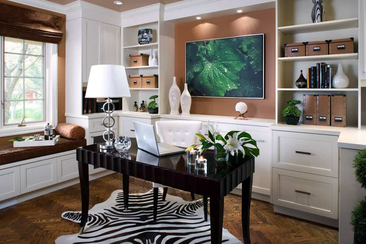 elegant-home-office-with-bookshelf-design-and-cowhide-area-rug