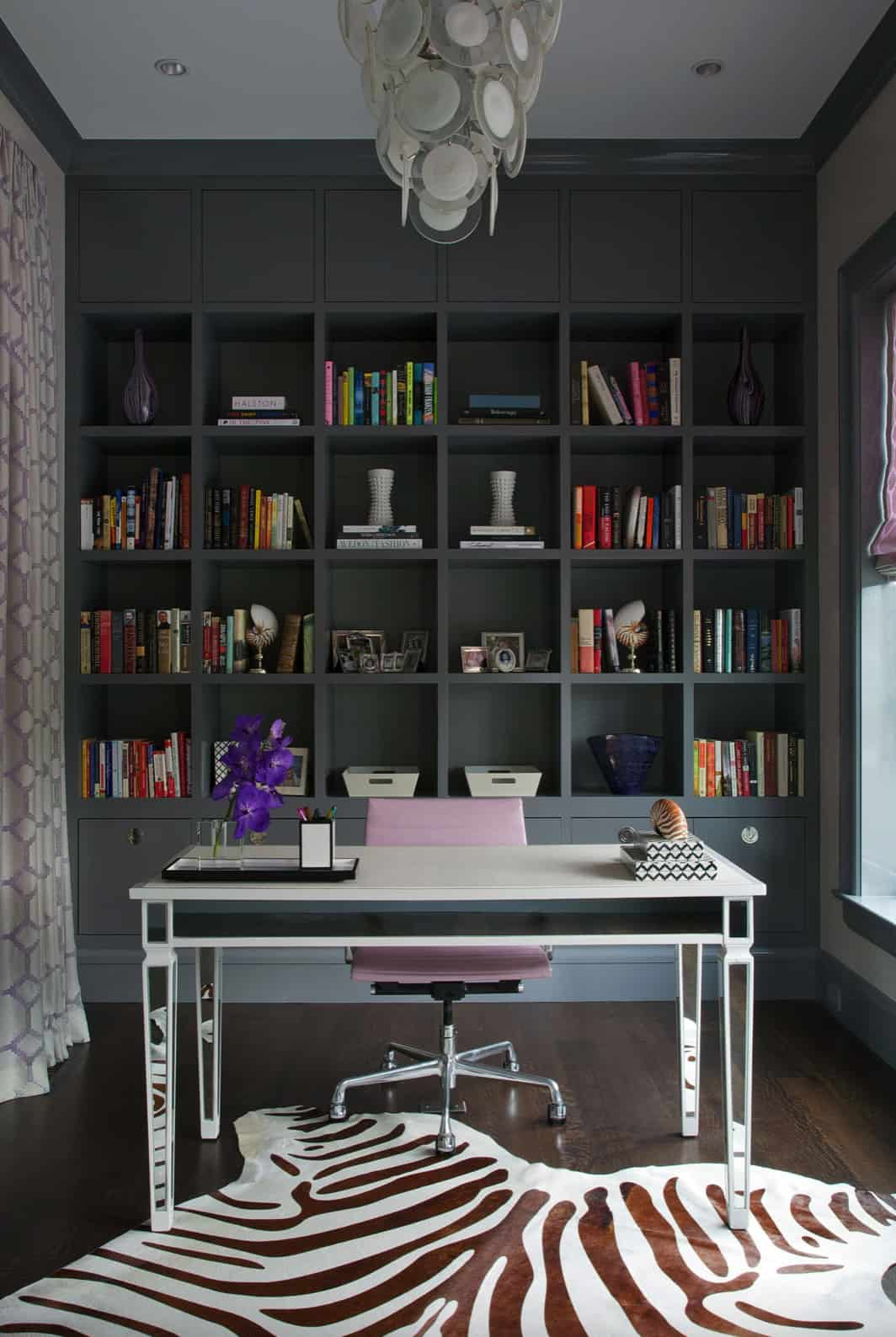 eclectic-home-office-with-a-bookshelf-wall