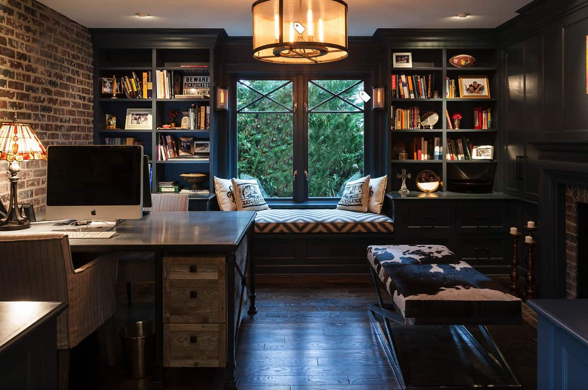 new-orleans-inspired-office-with-bookshelves-and-window-seat