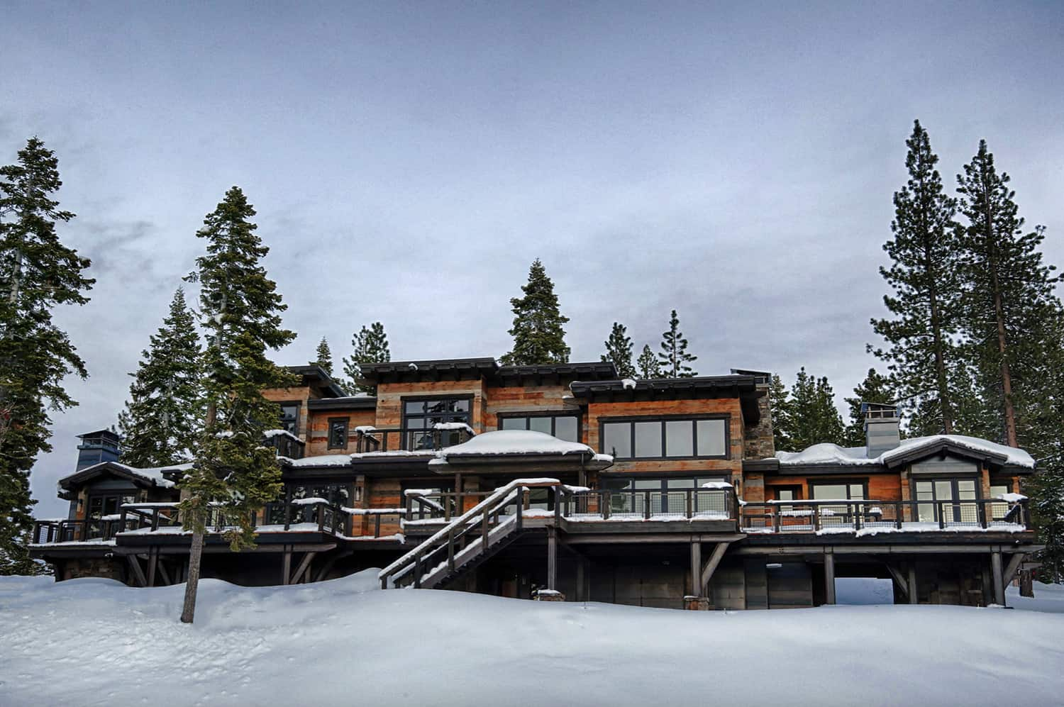 rustic-contemporary-mountain-home-exterior-with-snow