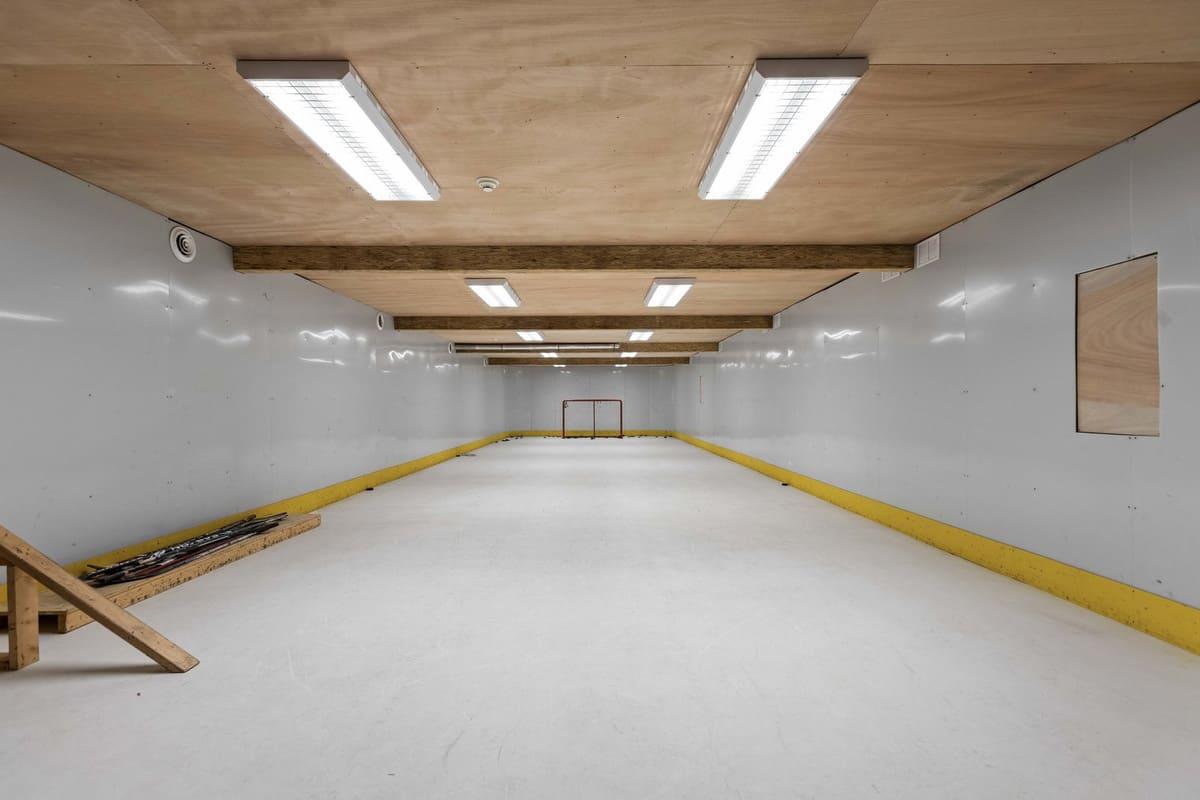 modern-farmhouse-basement-indoor-hockey-with-synthetic-ice-floor