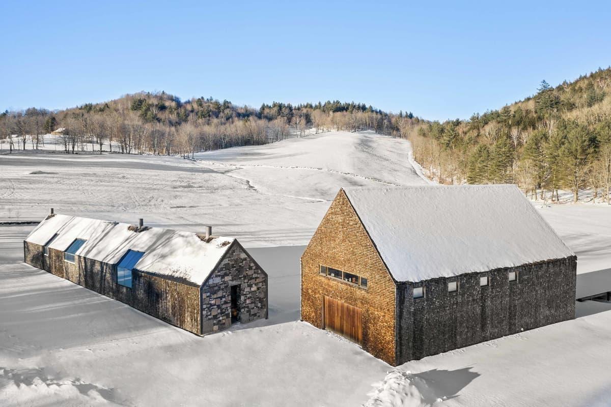 modern-farmhouse-exterior-with-snow