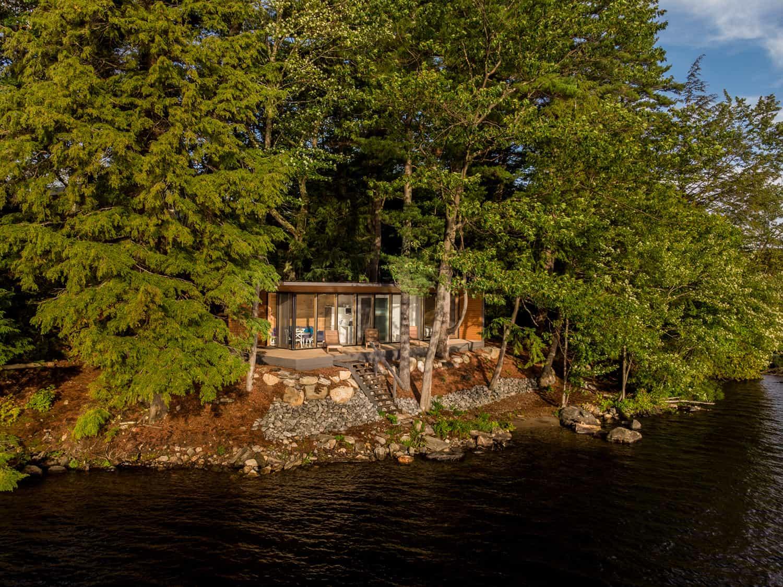 rustic-prefab-cabin-exterior-facing-the-lake
