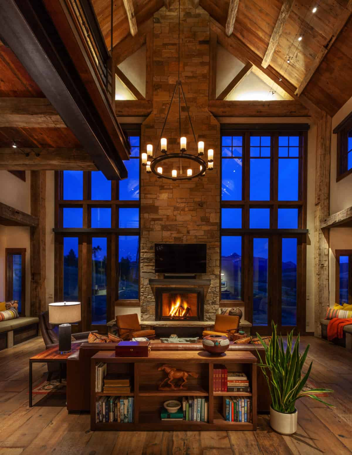rustic-living-room-with-a-stacked-stone-fireplace