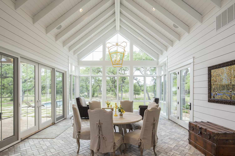 farmhouse-style-sunroom-with-dining-table