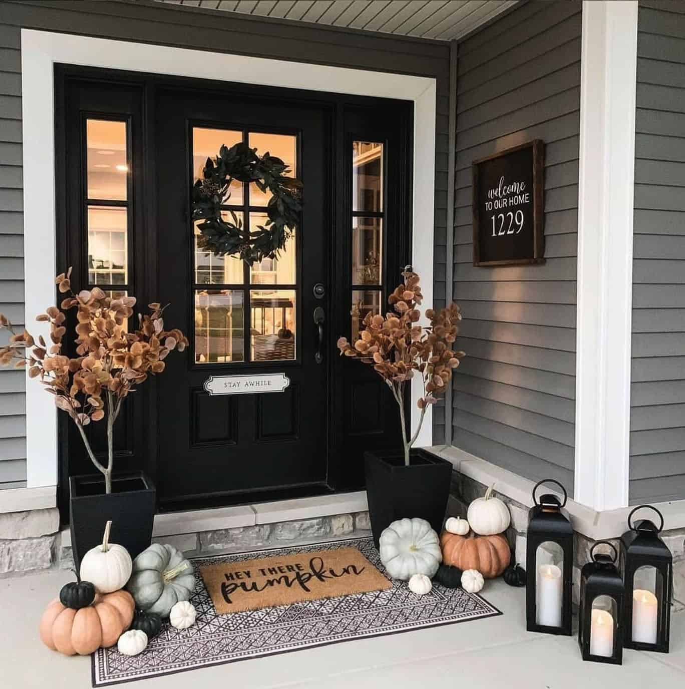 fall-front-porch-with-pumpkins-and-lanterns