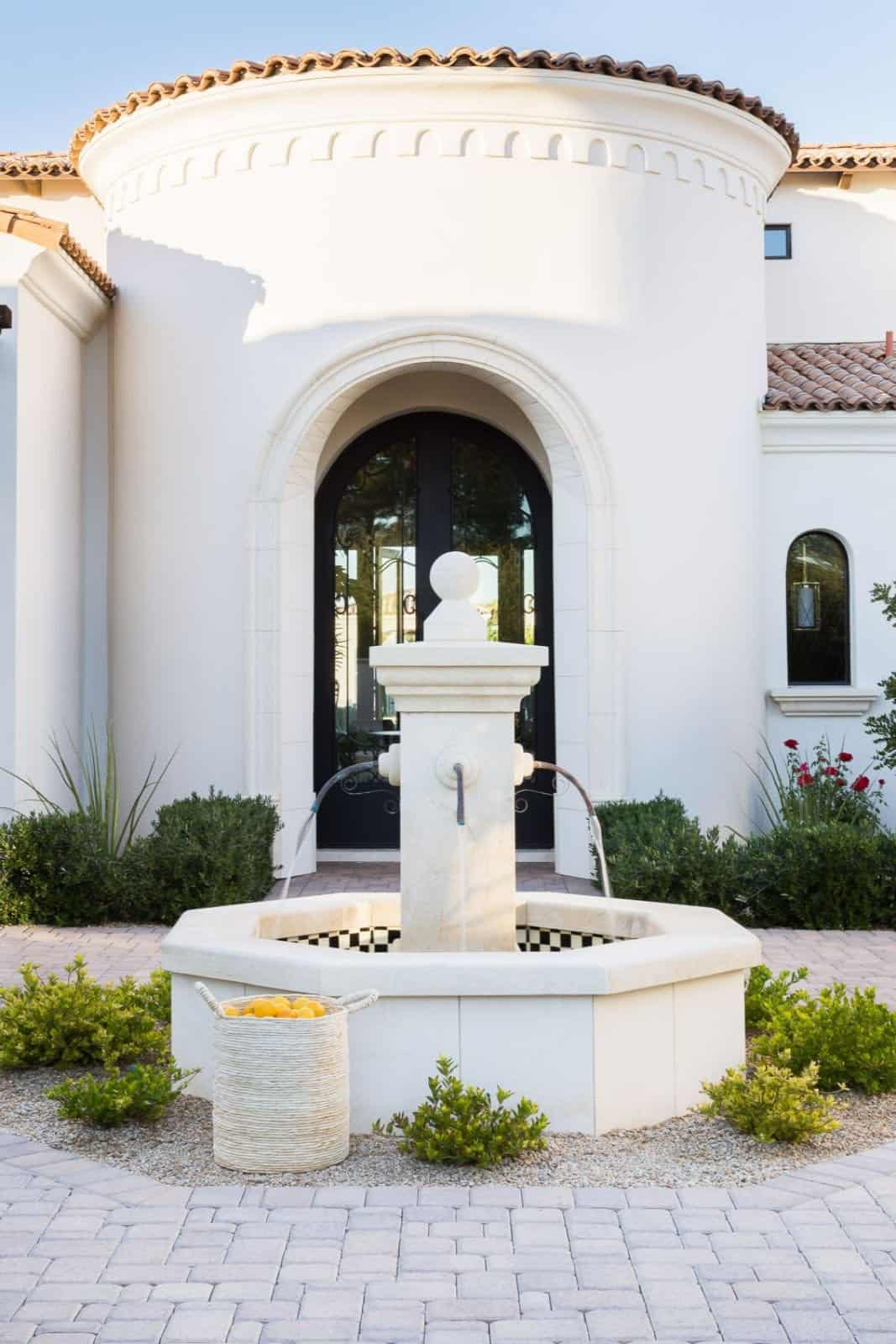 mediterranean-inspired-home-landscape-with-a-fountain