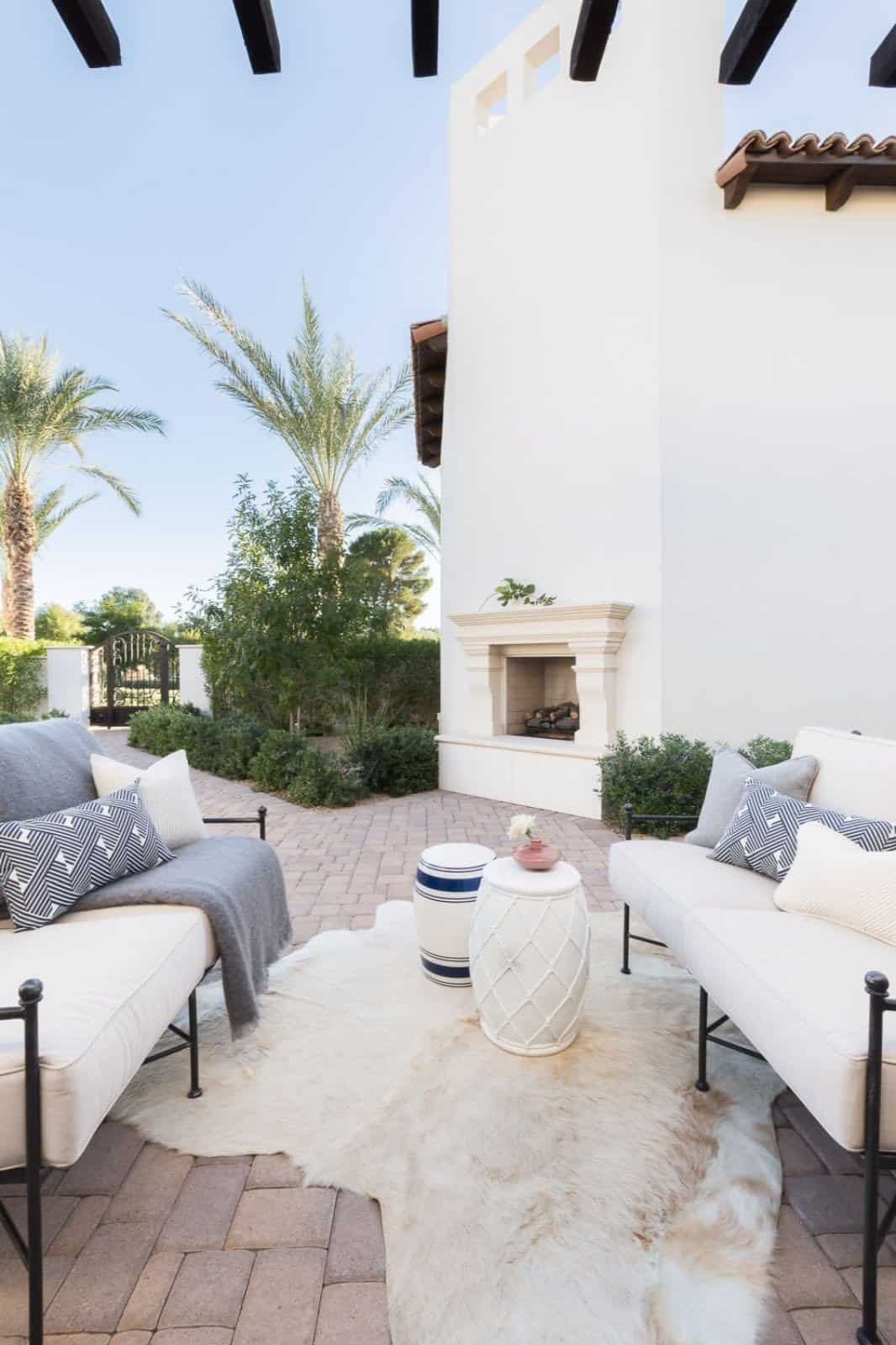 mediterranean-inspired-patio-with-furniture-and-fireplace