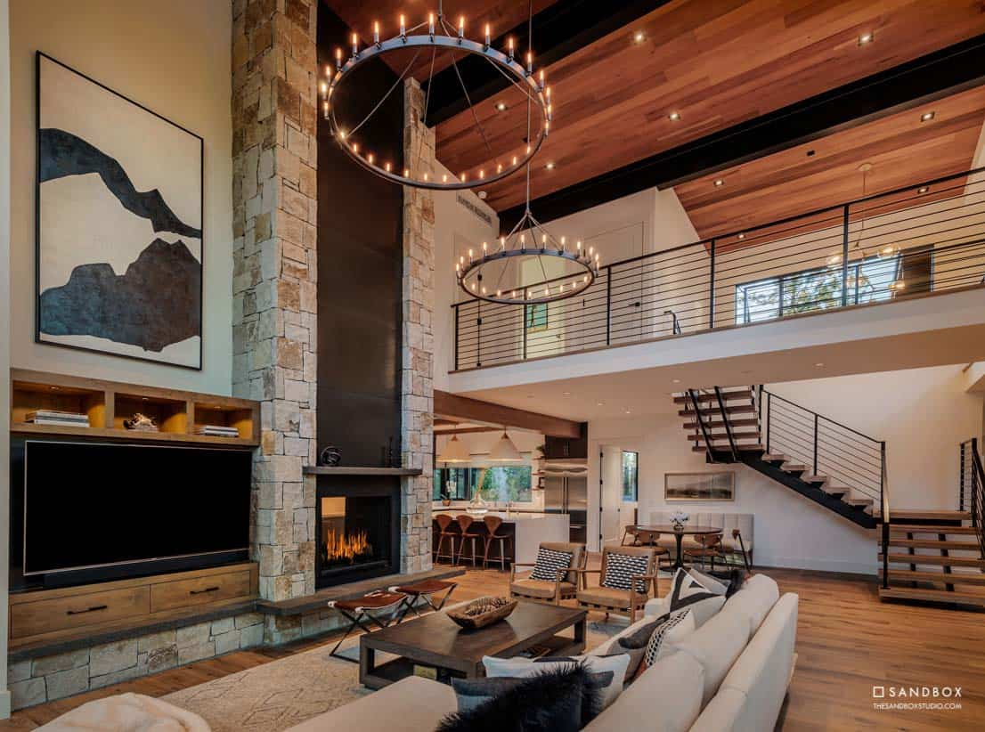 mountain-contemporary-home-great-room-custom-fireplace-floating-staircase