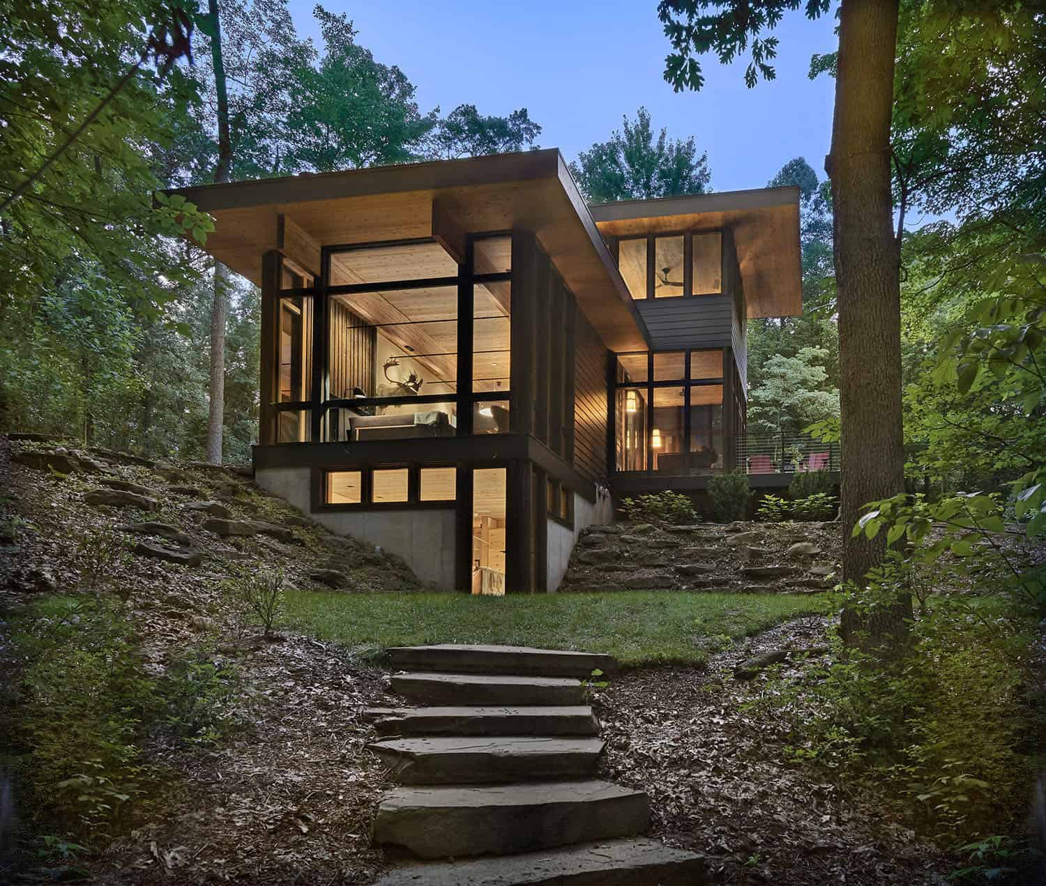 Reconnect with nature in a stunning Michigan retreat under a tree canopy