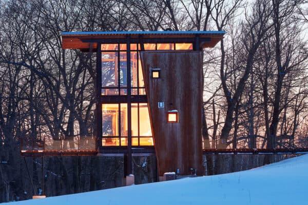 small-metal-cabin-exterior-night