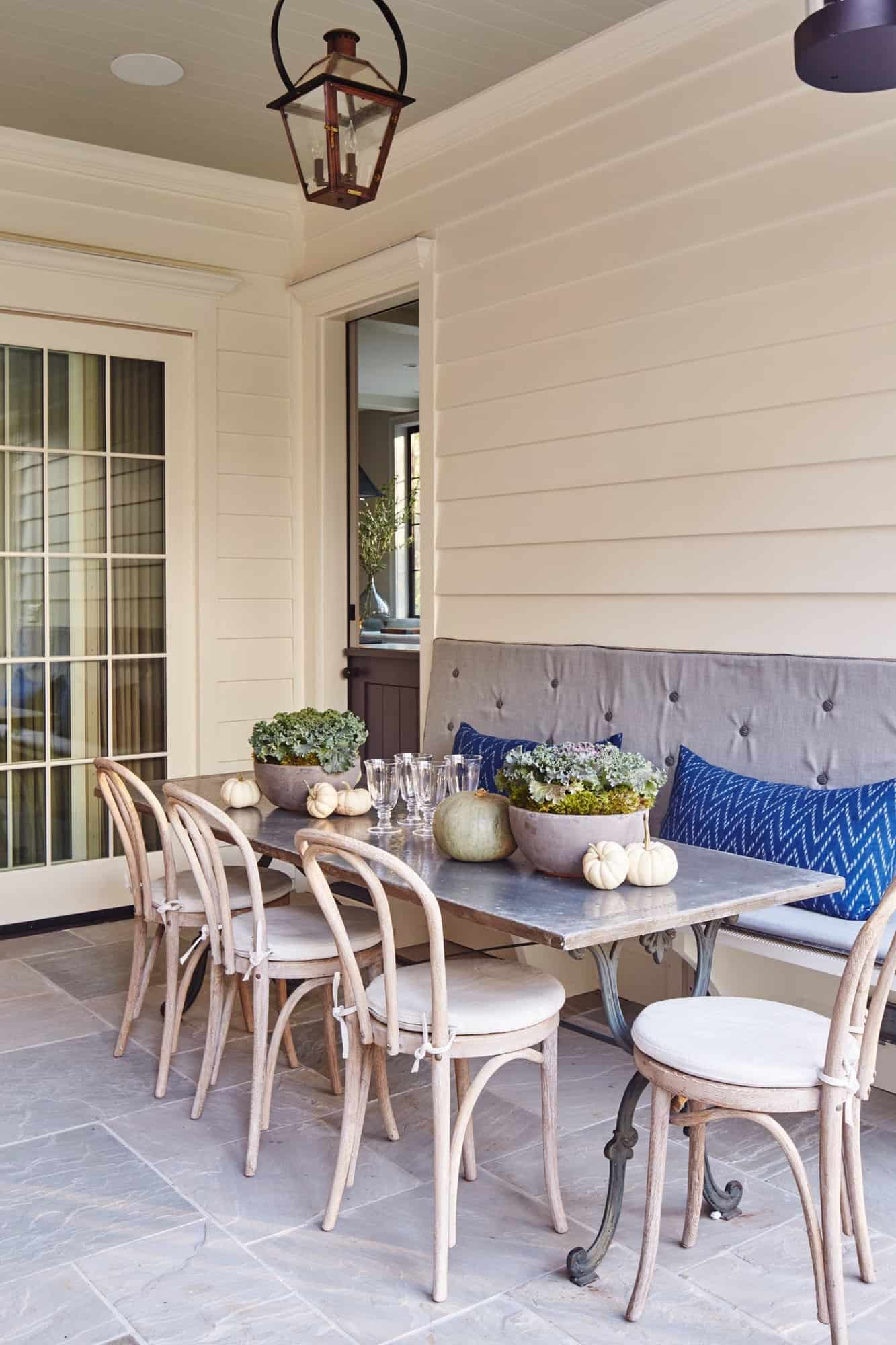 transitional-style-covered-porch-outdoor-dining