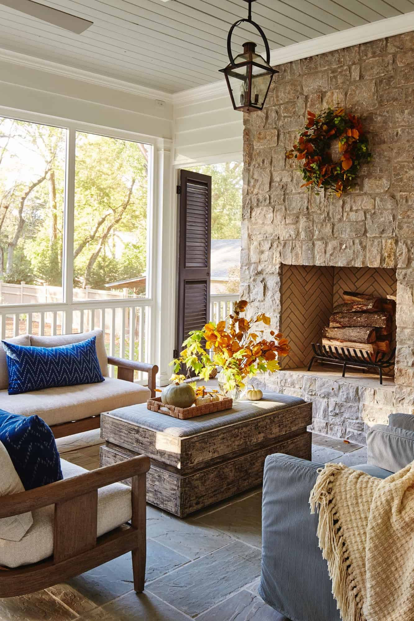 transitional-style-covered-porch-living-room-with-fireplace