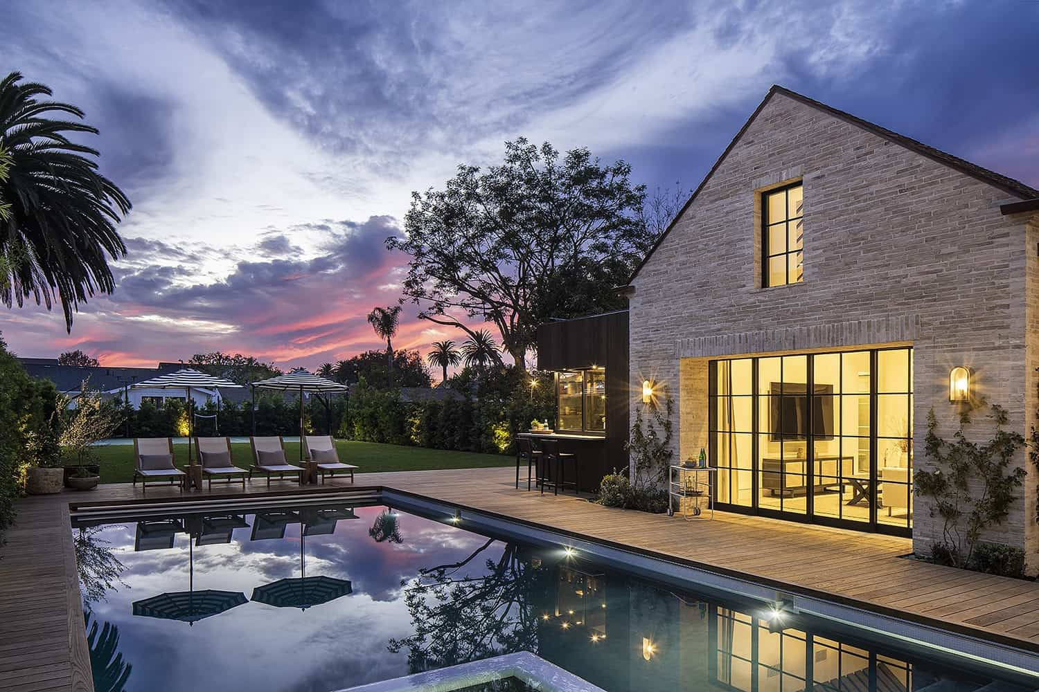 transitional-french-style-swimming-pool-dusk